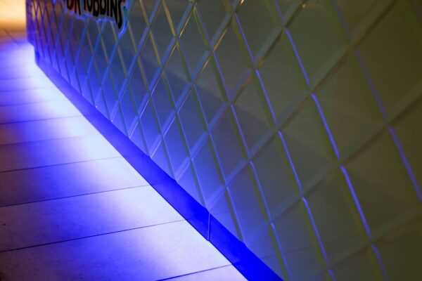 Tiling, And Blue LED Lighting At The Bottom Of White Gloss Finish Custom Joinery Fit Out By Impeccabuild. Hospitality Fit Out At Bankstown Sports Club Sydney By The Commercial Fit Out Experts Impeccabuild.